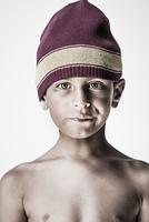 Serious mixed race boy in knit cap