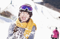 Chinese woman being hit by snow