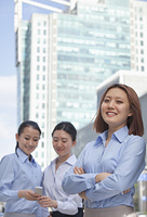 Smiling Chinese businesswomen