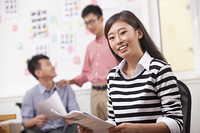 Chinese businesswoman smiling in office