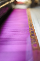 Close up of fabric threads in loom