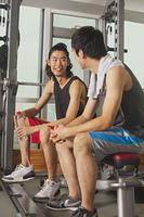 Chinese men talking in gym