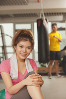 Chinese woman resting in gym