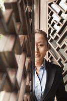 Chinese businesswoman standing in doorway