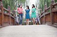 Chinese women on wooden walkway