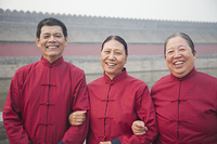 Older Chinese friends smiling in park