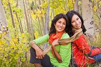Smiling friends enjoying forest