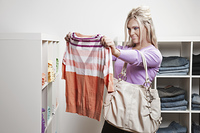 Caucasian woman shopping for clothes