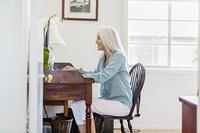 Older Caucasian woman at desk