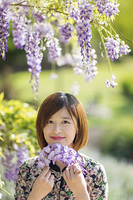 Chinese woman with flowers in park