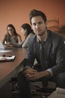 Caucasian businessman sitting at meeting table