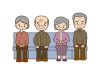 椅子に座る高齢者