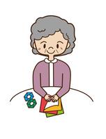 折り紙を折る高齢者