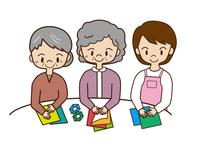 デイサービスで折り紙を楽しむ高齢者
