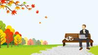 休憩するビジネスマン 秋の公園