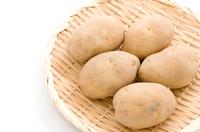 potatoes in bamboo sieve