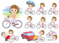 Straight bangs hair pink blouse women ride on city bicycle