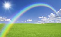 草原の赤い屋根の家と雲と虹と太陽
