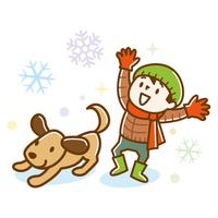 雪が降って喜ぶ子供と犬
