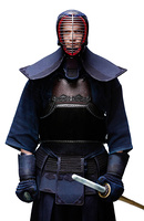 Portrait of equipped kendo fighter with shinai