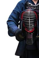 Close up of kendo helmet in hands of kendoka