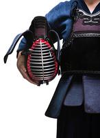 Close up of kendo helmet in hands of kendo fighter