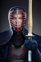 Kendo fighter with wooden sword