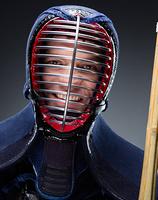 Portrait of kendoka with shinai
