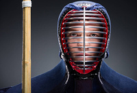 Portrait of kendo fighter with shinai