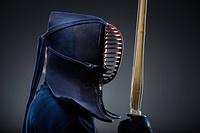 Profile of kendoka with shinai