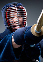 Close up of kendo fighter training with shinai