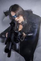 Handgun, Dangerous woman dressed in black latex, armed with gun.