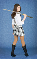 Beautiful girl with japanese sword on a shoulder