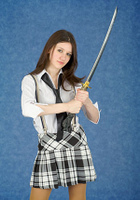 Young woman with the Japanese sword in a hands
