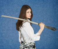 Young woman with the Japanese sword in a hand