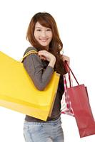 Happy smiling shopping gir
