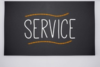 Service written on big blackboard