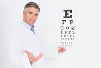 Optometrist looking at camera