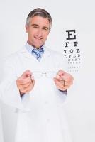Optometrist holding eyeglasses out