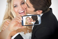 Couple taking selfie on smartphone