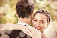 Portrait of happy bride embracing groom