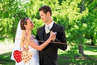 Composite image of couple dancing on wedding day