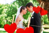 Composite image of loving newly wed couple in garden
