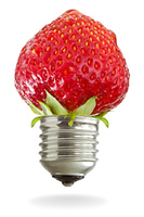light bulb with red strawberry