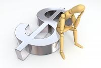 Lay Figure Sitting on Dollar Symbol
