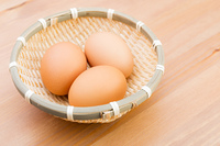 Egg in basket with wooden background