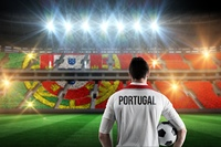 Composite image of portugal football player holding ball