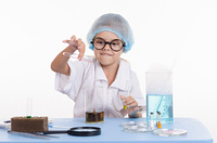 Chemist pours liquid from test tube into a flask