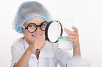 Chemist examines a flask under magnifying glass