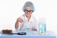 Girl Chemist pours liquid from a test tube into flask